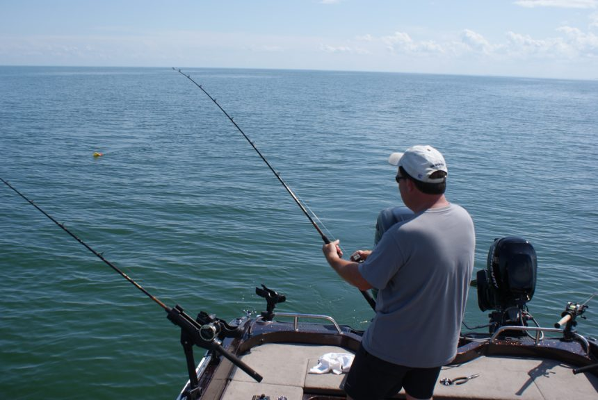 Image of man fishing for walleye for Walleye contest flyer