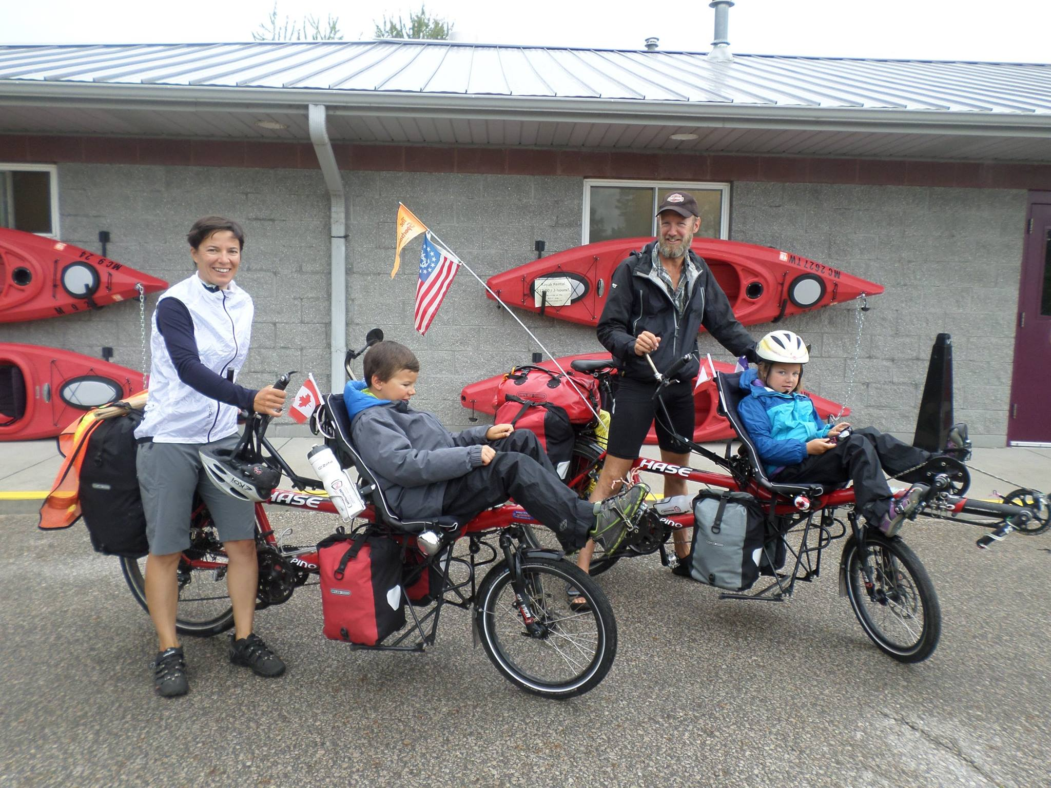 Campground vacationers on bikes with kids
